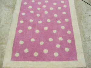 Pink rug with vomit removed